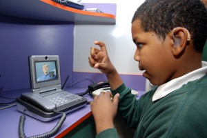Deaf kid using a videophone